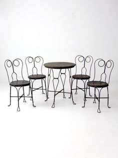 A Vintage Ice Cream Parlor Table And Chairs Set. The Black Metal Bistro  Table And