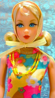 "She got a new look in 1969 - a new hairstyle, the ""Marlo"" flip style... a shoulder-length flip, inspired by the hit TV show ""That Girl"" which ran from 1966 to 1971. This Barbie is often referred to as TNT Flip or TNT Marlo Barbie. From Bloom Bursts 