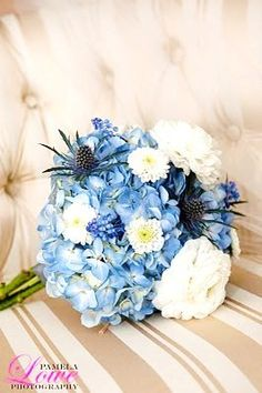 Blue and White Bouquet: Blue Hydrangeas, white open cut ranunculus, thistle, buttons, and muscari