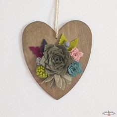 Natural rustic wooden heart decorated with colorful felt