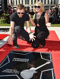Miranda Lambert posed with her star at the Nashville Music City Walk of Fame in shady style! Gotta love her oversized black butterfly sunnies.