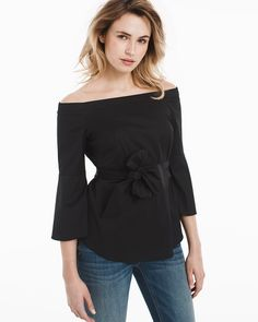 """What's our favorite off-the-shoulder look this season? It's a tie—our black poplin version features a removable self-belt that can be tied in the front or back. The body-loving shape shows just enough shoulder and has a coveted bell sleeve—perfect for peeking out from under the sleeves of a Trophy Jacket.   Black bell-sleeve shoulder-baring top Removable self belt Approx. 27"""" from shoulder Cotton/nylon/spandex. Machine wash cold; may be dry cleaned.  Imported"""