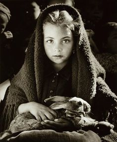 Jean Dieuzaide La petite fille au lapin. Nazaré, Portugal, 1954--Reminds me of a picture my Omi took during WWII