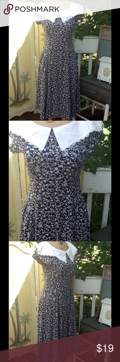 "VTG 70s FLORAL PARTY DRESS Pretty VTG 70s party dress,features a white portrait collar(not removable unless you cut it off) on a navy background with tiny white flowers,back zipper...this is a fit and flare dress,it's more fitted in The waist and flares out at the skirt,very flattering silhouette..feels like a cotton blend,no tags in excellent condition best fit upto a sz M,remember VTG fits smaller than modern day please compare with a garment you already have: measurements: L:45"", B:38…"