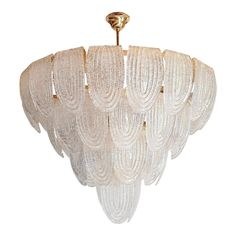 Large Vintage translucent and textured Murano glass chandelier, with gold-plated frame and chain. Three chandeliers available: priced and sold individually. The Mid-Century Modern Murano chandelier is attributed to AV Mazzega, Italy, 1970s Can be hanged as a flush mount fixture, or as a chandelier, Height of glass only 24.40 in. Height of glass with central stem: 28.74 in. (minimum height) Height with canopy: 39.37 in. Total height with chain and canopy 60.63 in. 12 lights, candelabra base socke Stained Glass Chandelier, Murano Chandelier, Vintage Chandelier, Vintage Lighting, Mid Century Modern Chandelier, Large Chandeliers, Luxury Lighting, Modern Lighting, Murano Glass
