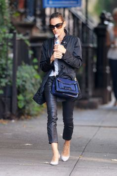 SJP was out and about New York City in chic cropped leather pants. She paired the casual look with a dark blue suede cross-body bag, complete with patent leather accents. Brand: Pierre Hardy