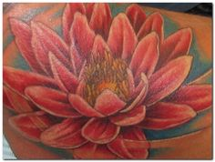 Lotus flower tat. Represents purity and rebirth. Love the colors