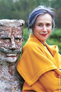 Beatrix Ost.  Beautiful with grey hair, perfect complexion, dark red lips and vibrant mustard colour jacket.