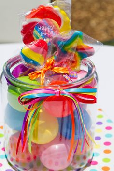 Rainbow suckers inside a glass jar filled with rainbow colored balls. Centerpiece at a Rainbow Party Rainbow Candy, Rainbow Balloons, Rainbow Theme, Rainbow Colors, Rainbow Lollipops, Rainbow Water, Water Balloons, Bird Birthday Parties, Rainbow Birthday Party