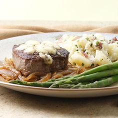 steak w/carmelized onions and gorgonzola. add 1/2 cup of roasted potatoes and asparagus. 500 calories.