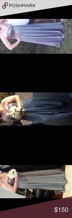 Silver prom dress Worn once  Few beads loose on the top  Size 14  Fitted for a size 12 Smoke free home Blush Dresses Prom