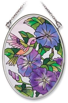 Amia Hand Painted Glass Suncatcher with Morning Glory and Hummingbird Design, 3-1/4-Inch by 4-1/4-Inch Oval by Amia. $11.00. Handpainted glass. Comes boxed, makes for a great gift. Includes chain. Amia glass is a top selling line of handpainted glass decor. Known for tying in rich colors and excellent designs, Amia has a full line of handpainted glass pieces to satisfy your decor needs. Items in the line range from suncatchers, window decor panels, vases, votives and much more.