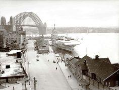 Old Sydney ~ Circular Quay, Sydney, 1940s  HMS 'Formidable' berthed at Circular Quay  Dated: c.1945