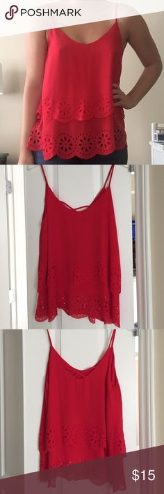 Red tank top Strapped layered flowy red blouse. Scoop neck, 100% polyester with lining. A bright pop of color for fall. Cute with a pair of skinny jeans! Never worn. Francesca's Collections Tops Tank Tops