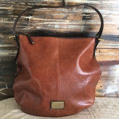 """Total Style-TIGNANELLO BAG BEAUTIFUL BROWN LEATHER- man-made trim and poly lining. 12""""x12""""x4"""". Secret side pockets. 29"""" + adjustable shoulder strap. Inside Zip pocket. Gently worn-GORGEOUS.  NO TRADES Tignanello Bags Hobos"""