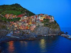 Cinque Terre, Italy. Composed by Monterroso, Vernazza, Corniglia, Mnarola and Riomaggiore; 5 small villages built at the rocky Liguria coast. Sandy beaches and car-free; only accessible by train... Heaven!