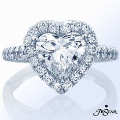 """It's National Proposal Day! Say """"yes"""" with this gorgeous heart-shaped ring edged in pave. #heartshape #diamondring"""