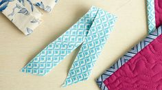 Custom-made binding tape adds a gorgeous finishing touch to your quilts, allowing you to play around with colors and prints. Binding tape is typically used to bind quilts and can be made with fabric that has been cut on the straight of grain. Ashley Nickels demonstrates how to create your own...