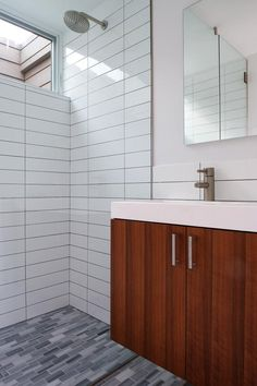 The bathrooms feature hard-wearing, durable materials which are easy to maintain.