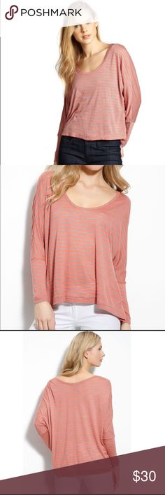 BCBGMaxazria Willa Slouchy Stripe Top size small Meet Petra. A slouchy long sleeve tee top from BCBGMaxazria, her bright stripes of coral and tan define her slightly sheer fabric. She is cut with a chic oversized fit, comfortable as a bottom layer as well as on her own. Seamed at the back, long dolman sleeves, u-neck. Striped stretch jersey knit. Rayon/Lyocell fabric blend. Hand washable. Size small. (L4) Offers warmly welcomed. BCBGMaxAzria Tops