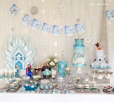 A charming and elegant dessert table for this Frozen themed party
