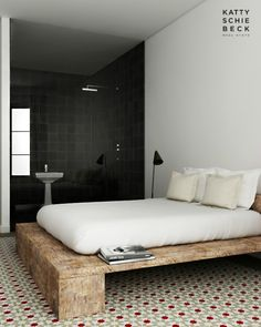 I love the wood bed frame like this, but would hate to stub a toe on it!! Yikes!! But looks amazing :)