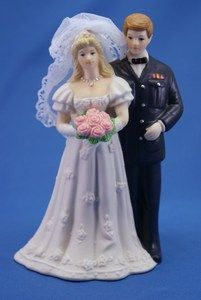 """The pride of service and love are displayed with taste with these hand painted porcelain figurines standing side by side with his bride, ready to build a future together. It measures 6.25"""" by 2.5"""""""