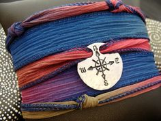 D2E handmade hammered and hand stamped Compass design on aluminum. Adjustable hand dyed silk ribbon wrap bracelet, with magnetic clasp. By D2Egallery, $29.00