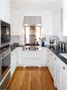 Contrast white cabinets with dark counter tops