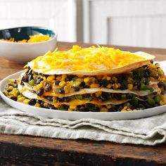 Black Bean Tortilla Pie Recipe -I Have it on good authority that it's delicious without the cheese and oil Mexican Dishes, Mexican Food Recipes, Vegetarian Recipes, Cooking Recipes, Vegetarian Mexican, Microwave Recipes, Vegetarian Dinners, Ethnic Recipes, Tortilla Pie
