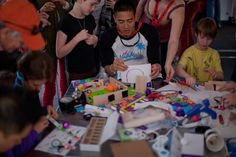 #SXSW  attendees young and old participate in the #Littlebits workshop to redesign their favorite board game.