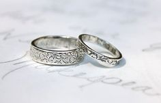 """Our wedding bands.  Silver wedding bands, engraved with a simple vine design on the outside and """"happily ever after"""" on the inside. Recycled silver. By peacesofindigo on Etsy.com"""