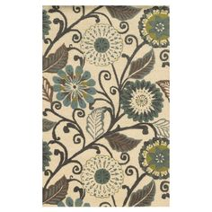 Anchor your living room seating group or define space in the den with this hand-tufted wool and art silk rug, featuring a blooming floral motif for eye-catch...
