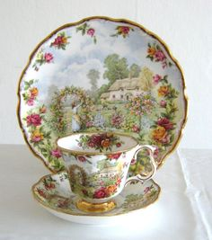 This absolutely stunning Royal Albert set consists of cup, saucer and collector plate produced in 1986 to celebrate the 25th anniversary of Old