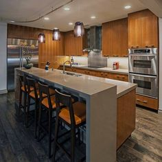 Isn't this kitchen designed by David Rance Interiors the ultimate combination of inviting, functional and contemporary? The edgy island built in Silestone really draws the room together.