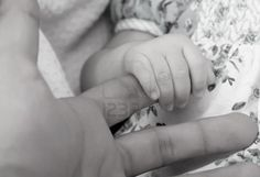 Father and son hands, black and white image Stock Photo