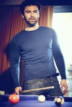 Aidan Turner and he's wearing blue again and looking gorgeous as he'll!