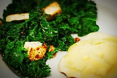 Marinaded, pan-seared tofu with kale and cheese-topped bread
