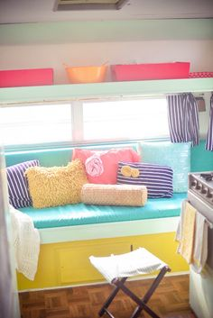 Pretty Pastel Vintage Camper Interior. Navy stripe, aqua, orange, pink coral-y, yellow