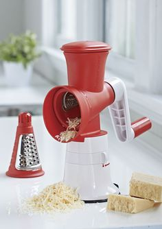 Grate Master™ Shredder. The healthy solution to preparing quick and easy fruit or vegetable salads, appetizers, spring roll fillings, shredded cheese and other dishes and garnishes. Use the coarse cone for grating into larger pieces (add big yum!) and the fine cone for shredding into small pieces (for hidden veggie recipes!).
