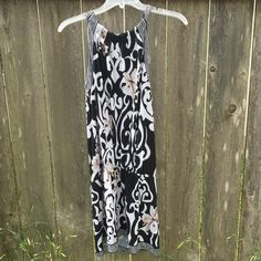 {White House Black Market Dress} So cute! Unique drop waist dress. In great condition. Black and white pattern with flowers. True to size. White House Black Market Dresses