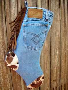 Palomino jean Christmas stocking, light blue denim, hand cut leather fringe, palomino horse sued print, original jean label, 22 inches tall