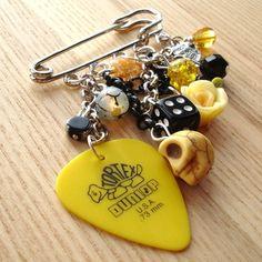 Yellow Rock Chick Plectrum and Skull Kilt Pin Brooch
