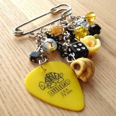 Maybe Guitar Pick could be used in a key chain