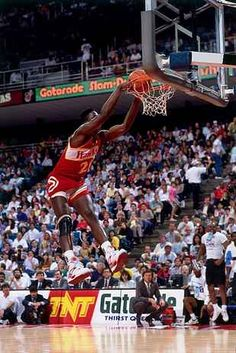 Dominique Wilkins of the Atlanta Hawks throws down a two-handed dunk with power during the 1990 Gatorade Slam Dunk Contest played at the Miami Arena on Feb. Sports Basketball, College Basketball, Basketball Players, Sports Teams, Basketball Jones, Basketball Diaries, Basketball Court, Jordan Basketball, Basketball Uniforms