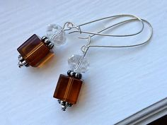 $8.00.  Smoky Topaz Cube Earrings.  What only $8.00??  I simply must have these!  :)