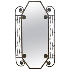 1930's French Art Deco iron Wall Mirror   From a unique collection of antique and modern wall mirrors at https://www.1stdibs.com/furniture/mirrors/wall-mirrors/