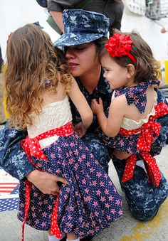 Navy Petty Officer Class Jerrilynn Sweat hugs her daughters during a homecoming ceremony in San Diego, Calif. DoD photo by Petty Officer Class Chelsea Radford, U. Military Women, Military Spouse, Military Life, Military Families, Military Wedding, Military Veterans, Homecoming Week, Military Homecoming, Homecoming Ideas