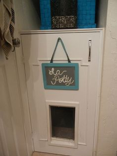 Behind that door is a cat box. This guy took the shelves out of a bathroom cabinet, added a kitty door, and made a stealth cat crapper. Awesome! http://media-cache5.pinterest.com/upload/57702438945196903_3jx6e0y9_f.jpg  foxglove for the home bathrooms
