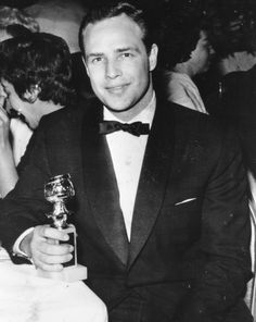 Marlon Brando photographed with his Golden Globe for Best Actor at the 12th Golden Globes on February 24, 1955. He won the award for his performance in On the Waterfront.